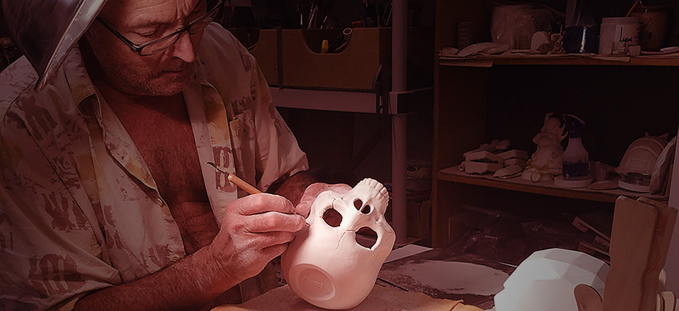 PopTiki working on a skull mug.